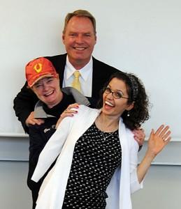 Three graduates celebrate a successful dissertation defense.