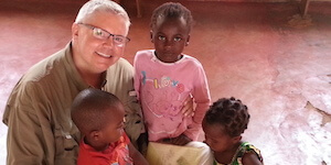 Gus with Kids in Typical Malawi Church Building