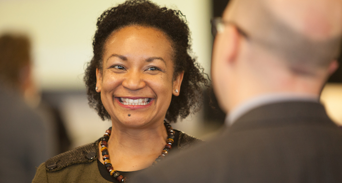 Jeffries talks with another executive at a leadership development workshop.