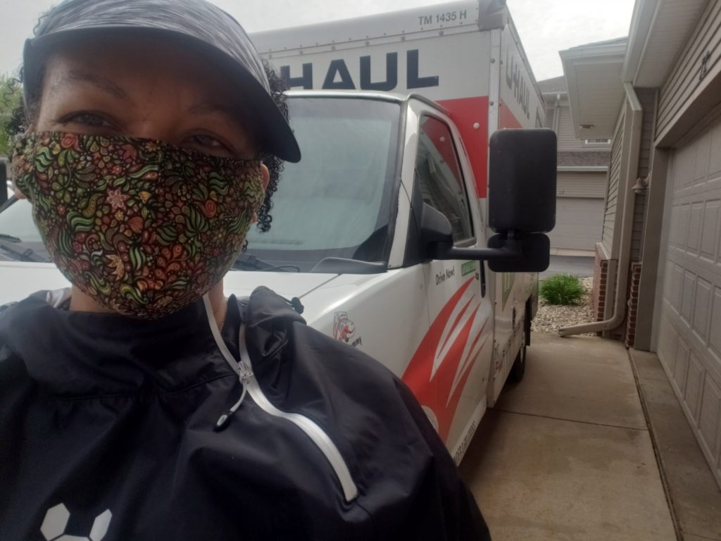 woman in face mask delivers food with uhaul